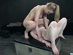 Curvaceous Sybil Hawthorne licks Annette Schwarz's pussy and gets tied up. After that she gets her tight vagina drilled with a strap-on.