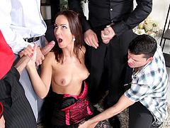 She is a dirty fucking whore and she can not get enough cock in her mouth and pussy. Simone works two cocks at the same time while her pussy is rubbed by another guy. Then, she kneels and takes care of three cocks by sucking and rubbing them while the fourth guy rubs her pussy.