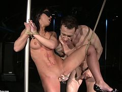 Dirty-minded pale brunette is fond of bondage. So she gets blindfolded and tied up at once. Horny dude fingers her pussy, pins it with metal clothes pegs and then fucks hard in a standing position.