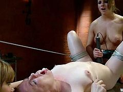 Three sexy babes make an amazing dondage show. The redhead girl gets tied up and toyed by two other girls.