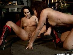 Two insatiable tasty looking lesbians enjoy playing raunchy lesbian games with BDSM elements. They tongue fuck each other's soaking snatches before pounding them with dildo.