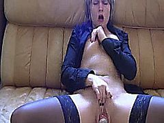 Extreme amateur slut buries a cola can and seven candles inside her cavernous cunt and masturbates till she orgasms