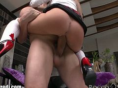 This naughty schoolgirl admires Rocco's sculpture and she assumes the same position when her English teacher goes away. Rocco fucks her with his massive cock and then the busty brunette as well.