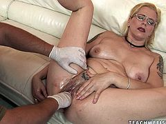 Caucasian dirty wench with big saggy boobs is sitting on a couch naked. She gets her cunt fisted hard so she moans wild with pleasure.
