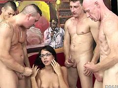 When taking a look at this strict looking brunette college chic, you will never guess that she is a true nympho. She takes part in wild gangbang sex party where she gives head to aroused class mates in turns before the bukkake on her face.