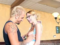 Lusty blonde whore with ugly face and small tits is seduced by horny dude. She kneels down giving him stout blowjob. She works hard on small cock using all her tricks and skills.