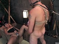 The Asian DragonLily is going to humiliate and strapon fuck this guy in this femdom session packed with bondage and torturing action.