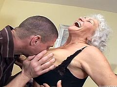 Slutty grandma Marinoka is mad for young cock. Than younger and harder, the better! She's fucking happy because she knows, she will get fucked by this dude. The guy grabs her soft saggy tits, licks them and then, she kneels to suck him hard. The experienced whore knows how to greet a cock with her lips!