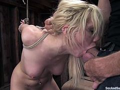 She knows that at the end he will stick his cock in her leaking pussy and so she waits for the moment, standing the abuse.