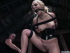 Enjoys some BDSM fantasies with Annette Schwarz and her master Mark Davis. She sticks his dick in her pussy, having her tied pretty tight!