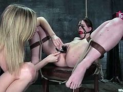 Sexy brown-haired chick gets tied up and toyed by a fucking machine. After that she gets toyed with different vibrators by her mistress.