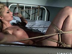 Delicious blond hottie gets fucked in missionary style by aroused male nurse