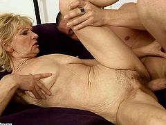 Extremely perverted grannie gives her lover a nice blowjob. Then she gets into sideways position to let him control the penetration.
