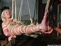 Sex-starved bimbo Angela hangs suspended by ropes over the floor and she is completely at the mercy of her mistress. Check out this hot BDSM scene and get ready to cum.