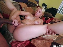 Curvy blonde Sarah Vandella with outstanding huge tits sucks black guys big cock and then gets her trimmed pussy fucked hard on the bed. She enjoys interracial sex with horny big dicked black man that drills her vagina in many positions.