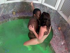 Jodi Taylor is a petite pale skinned teen girl that has a great time with hard dicked black guy in a jacuzzi. Small titty chick gets her white pussy drilled by dark dick before she sucks his pole!