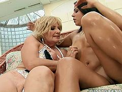 Alluring brunette trollop takes part in steamy old young lesbo fuck scene. She caresses her partners saggy boobs rubbing wet cunt intensively. Then kinky brunette girl goes down eating gushing juices wet snatch.