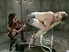 Sexy blonde girl gets undressed and tied up by hot brunette. Later on she gets her pussy toyed with an electric dildo and a vibrator at the same time.