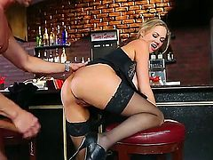 Pretty blonde babe Katie Kox with big juicy knockers and arousing heavy make up in high heels and black stockings seduces tall handsome Preston Parker rides on his him bar.