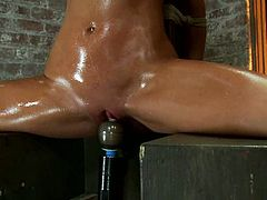 This smoking hot babe Blake Rose loves being suspended and oiled up. Then this dude sticks a toy in her snatch and she moans so shot about it!