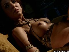 Ample red-haired doxy gets bandaged tight by insatiable brunette domina before she forces her sit with knees pulled up to stroke her punani with manicured fingers in BDSM-involved sex video by 21 Sextury.