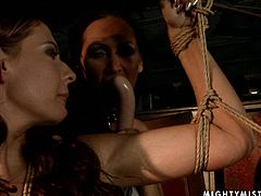 Rapacious red-haired MILF gets bandaged by aroused mistress so she can enjoy taking a though look at her tasty curvy body. Later she forces her to give a head to a dildo in BDSM-involved sex video by 21 Sextury.