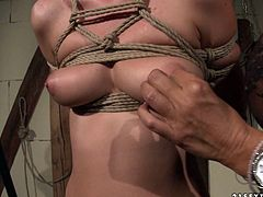 This brunette is a scorching mistress and this hot BDSM sex scene shows us her wild side! She binds her slave in ropes to ensure she can't wiggle her hands free.
