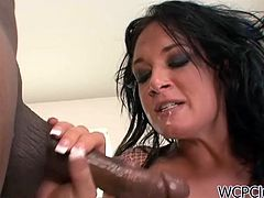 See the nasty brunette Torny Lane getting her throat banged by a huge black dong before riding it balls deep with her tight ass. She looks very perverse in those black stockings.