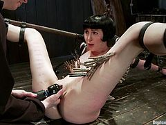 Kinky brunette girl gets tied up in some wooden house. Then her mistress fixes lots of clothespins to Coral's body. Then this poor chick gets toyed deep in her wet pussy.
