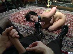 Kinky brunette girl gets tied up. Then she also gets her tits pinched. In addition she gets pounded from behind.