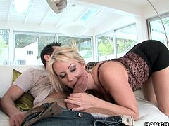 Watch this bust blonde mom riding this guy's large cock after sucking on it as you hear her moan with immense pleasure.
