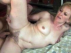 This old woman is an experienced slut and she knows how to make her lover happy. She gets into sideways position to let her lover pound her hairy twat hard and deep. Then she bends over for doggy style pounding.