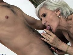 This granny is a super qualified slut when it comes to pleasing men. She sucks that rock hard erection greedily and then she spreads her legs wide to let her lover eat her hairy snatch.