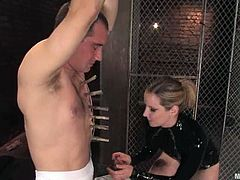 Poor Curt Wooster gets undressed and clothespinned by his horny mistress. After that she pours hot wax on his penis and toys the ass with a strap-on.