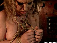 Perverse brunette domina in seducing fishnet tank bandages an ample red-haired MILF before she makes her suck a sex toy, which she later uses to tickle her snatch.