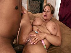 This older fatty seduces this young black dude by showing him her massive natural tits. He begins by slamming her cunt, but then he fucks something tighter.
