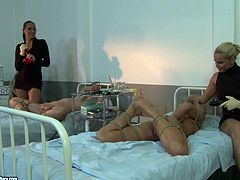 Welcome to see a bit rough and hot bondage session of three dykes in steamy 21 Sextury xxx clip. Booty brunette and blondie in black clothes tie up girlie with ropes and treat her soaking cunt with a red dildo on the bunk bed.