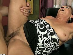 This bitchie old librarian is too horny. Brunette old whore with big ass and droopy boobs sucks fresh dick and then gets her mature soaking cunt polished missionary right on the table.