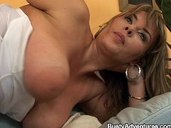 Slutty chick with huge boobs and big nipples toys the pussy with a dildo. Later on she sucks the guy off and gets fucked from behind.