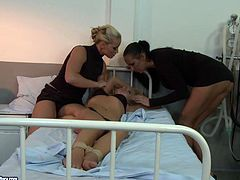 Welcome to the kinkiest and madest hospital ever along with 21 Sextury xxx clip. Blond haired girl in pink lingerie is tied up with ropes. Horny booty brunette and blondie jam her tits and rub her clits right on the bunk bed, causing her loud moans.