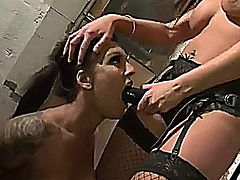 emma butt has her way with another girl in a factory using tongues, fingers, toys and a strapon