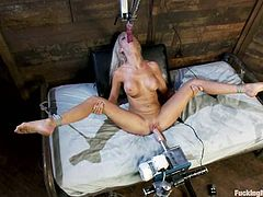Lovely Kaylee Hilton sucks huge dildo to make it wet. Later on she gets her juicy vagina and tight ass toyed at the same time by brand new fucking machine.