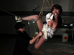 Petite Japanese girl in nurse uniform gets tied up and gagged. After that she gets her vagina toyed and tits tortured with claws.