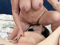 This old woman with big luscious tits knows what she wants and does a fine job of getting it. She sits on her lesbian friend's face and lets her eat her juicy pussy.