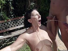 Whorish brunette mature is a well known slut. She stands on her knees surrounded by a crowd of horny daddies whom she gives blowjob in turns in gangbang sex orgy by 21 Sextury.