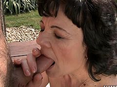 Immense old BBW with a slack body and baggy tits lies on the deckchair getting her bearded pussy eaten by young pervert before she takes him slim dick into her mouth for a blowjob.