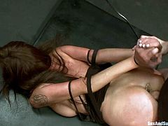 Gorgeous brunette Princess Donna Dolore is having fun with James Deen and his buddy in a basement. The dudes bind the hottie, beat her with a stick and then fist her snatch and double penetrate her.