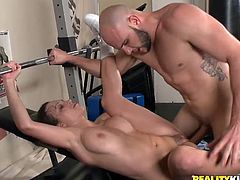 Lovely babe gives a blowjob to the fitness instructor and gets titty fucked in a gym. Then she rides his big cock passionately.
