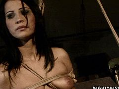 Worn out brunette hoe with a flowing make up gets tied to the pole by insatiable mistress with tits squeezed hard before she starts stroking her bald pussy wtih her hand in BDSM-involved sex video by 21 Sextury.