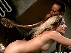 Incredibly perverted blondie is chained to a tree by horny mistress. Cruel mistress tortures her slave by whipping her bare ass. Make sure you don't miss this hot BDSM sex video.